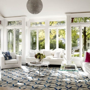 sunroom with a funky fun design disco ball glass tables and white furniture colorful accents