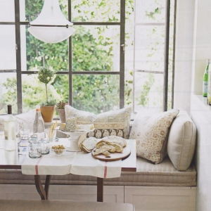 closup photo of a cream and brown sunroom built in bench seating