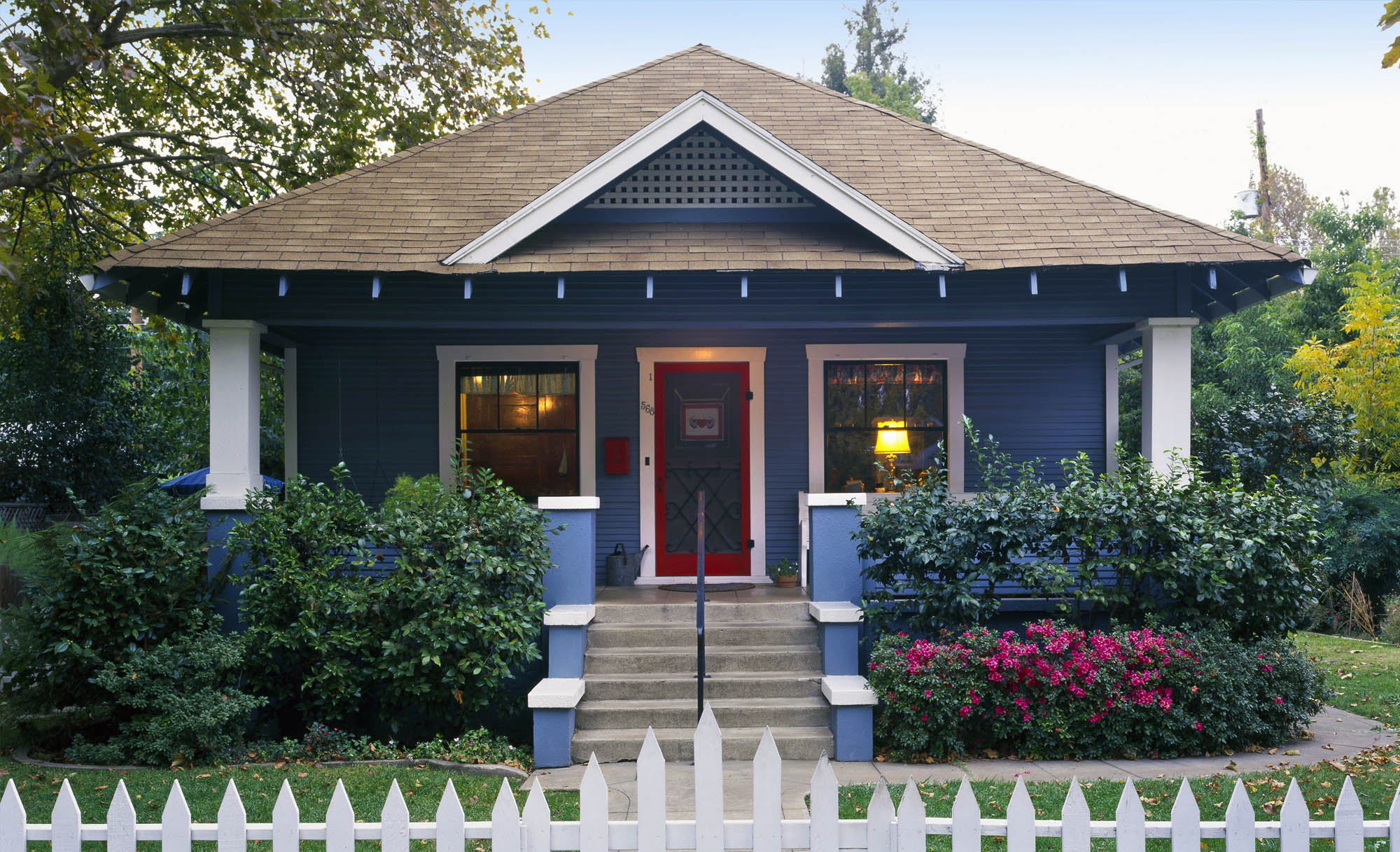 small house color schemes - blue siding with white trim and a red door