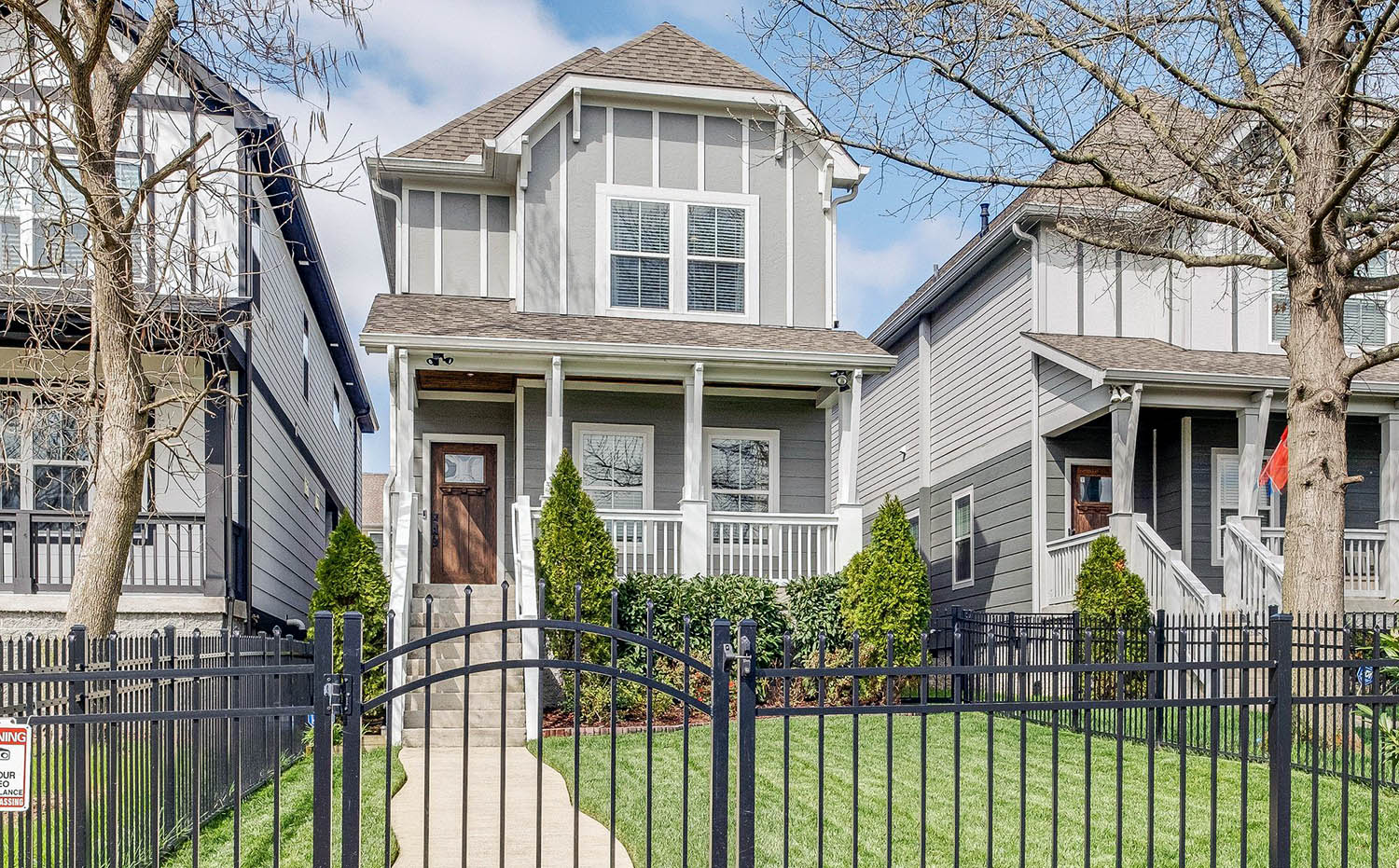Little Gray House With White Trim & Wood Front Door