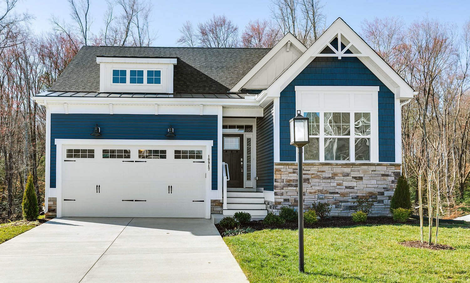 Small Royal Blue Home With White Trim & Coffee Bean Front Door