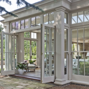 beautiful exterior view sunroom white trim lots of glass all glass walls nj custom sunroom builder