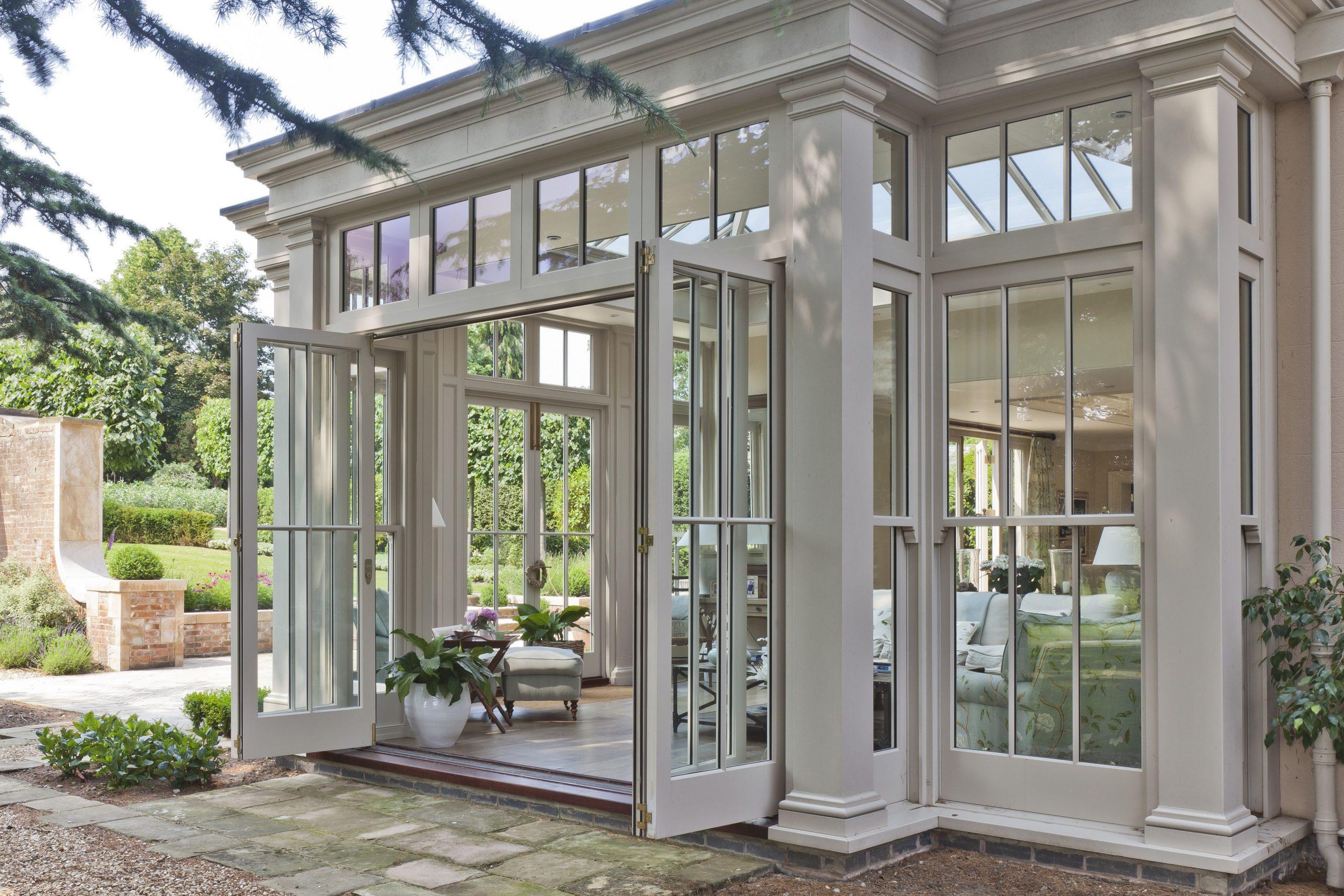 beautiful exterior view sunroom white trim lots of glass all glass walls nj custom sunroom builder