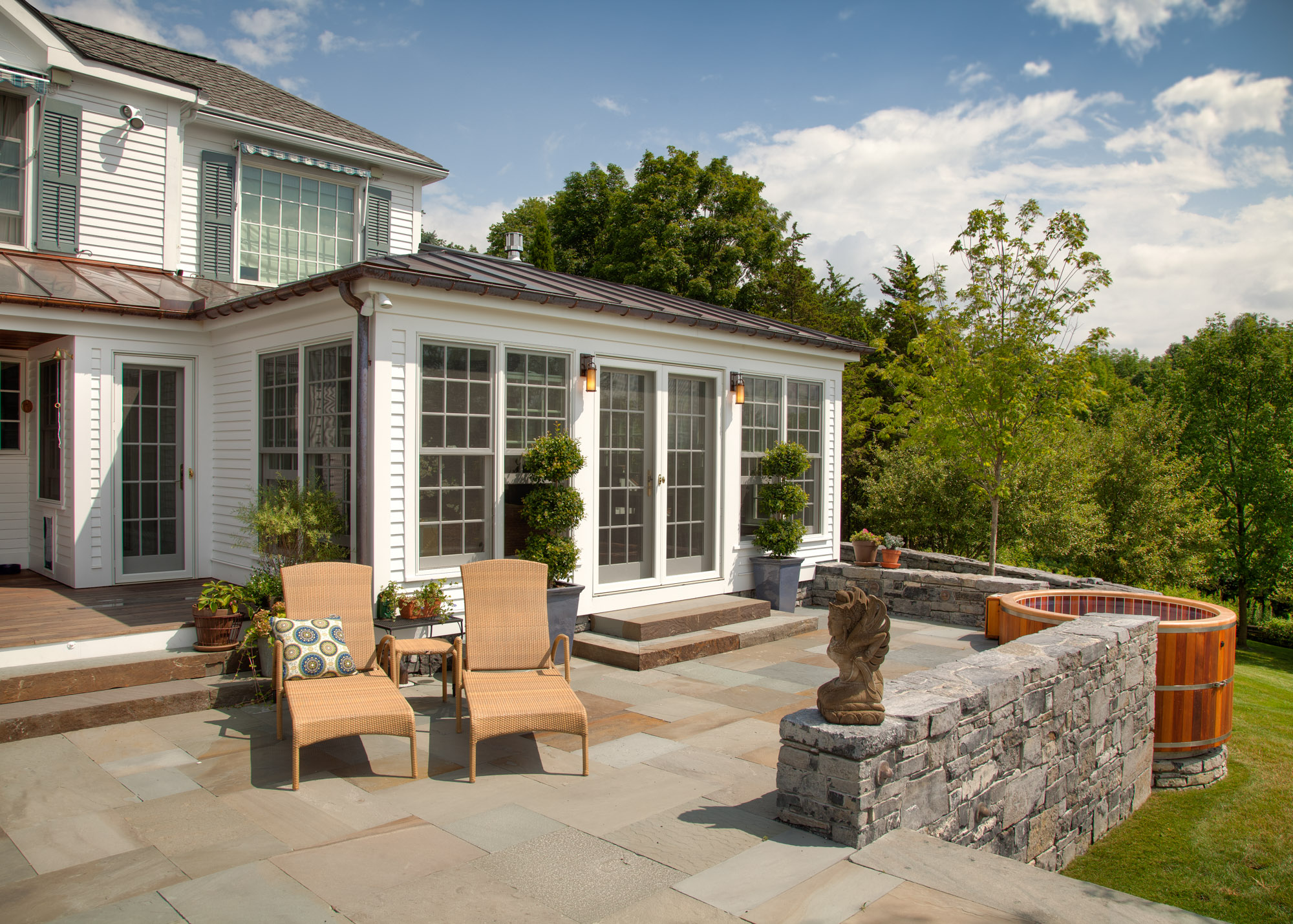 beautiful sunroom exterior view bluestone sunroom patio metal roof custom sunroom builder nj Gambrick