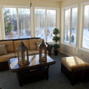 sunroom in winter dark furnitre with tan cushions nj custom sunroom builder