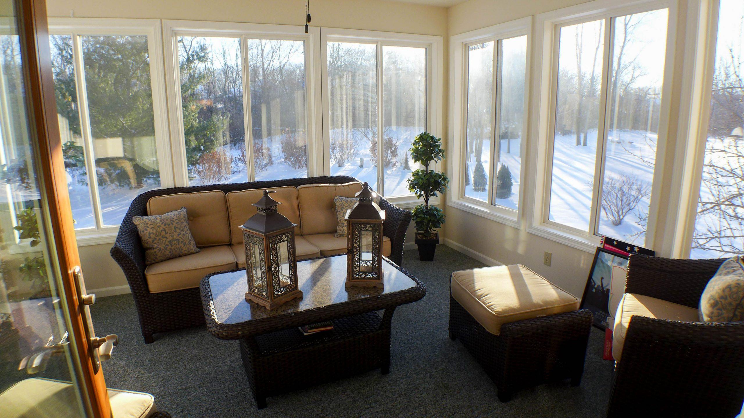 sunroom in winter dark furnitre with tan cushions nj custom sunroom builder