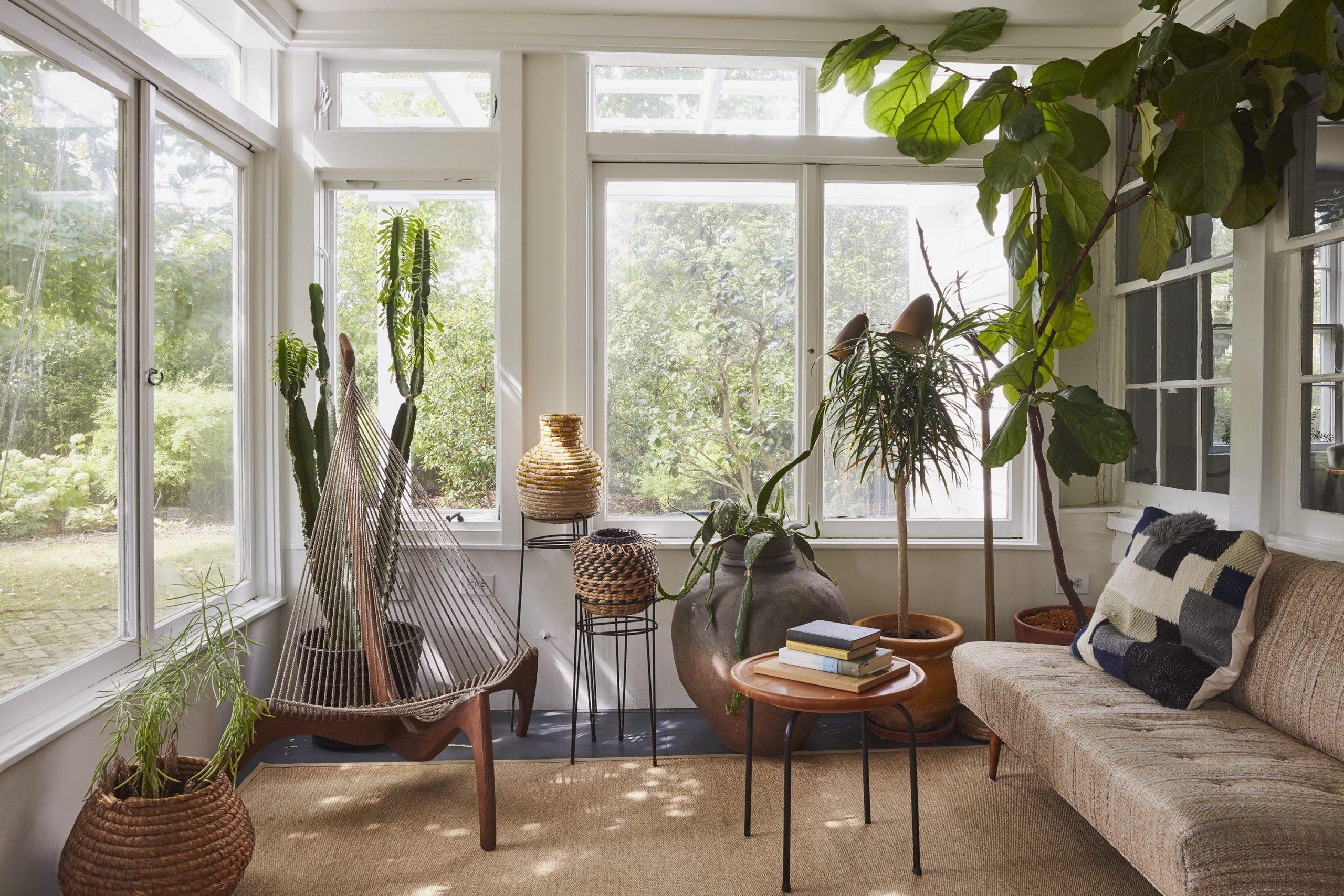 porch sunroom lots of planst and natural light natural color palette custom sunroom builder nj