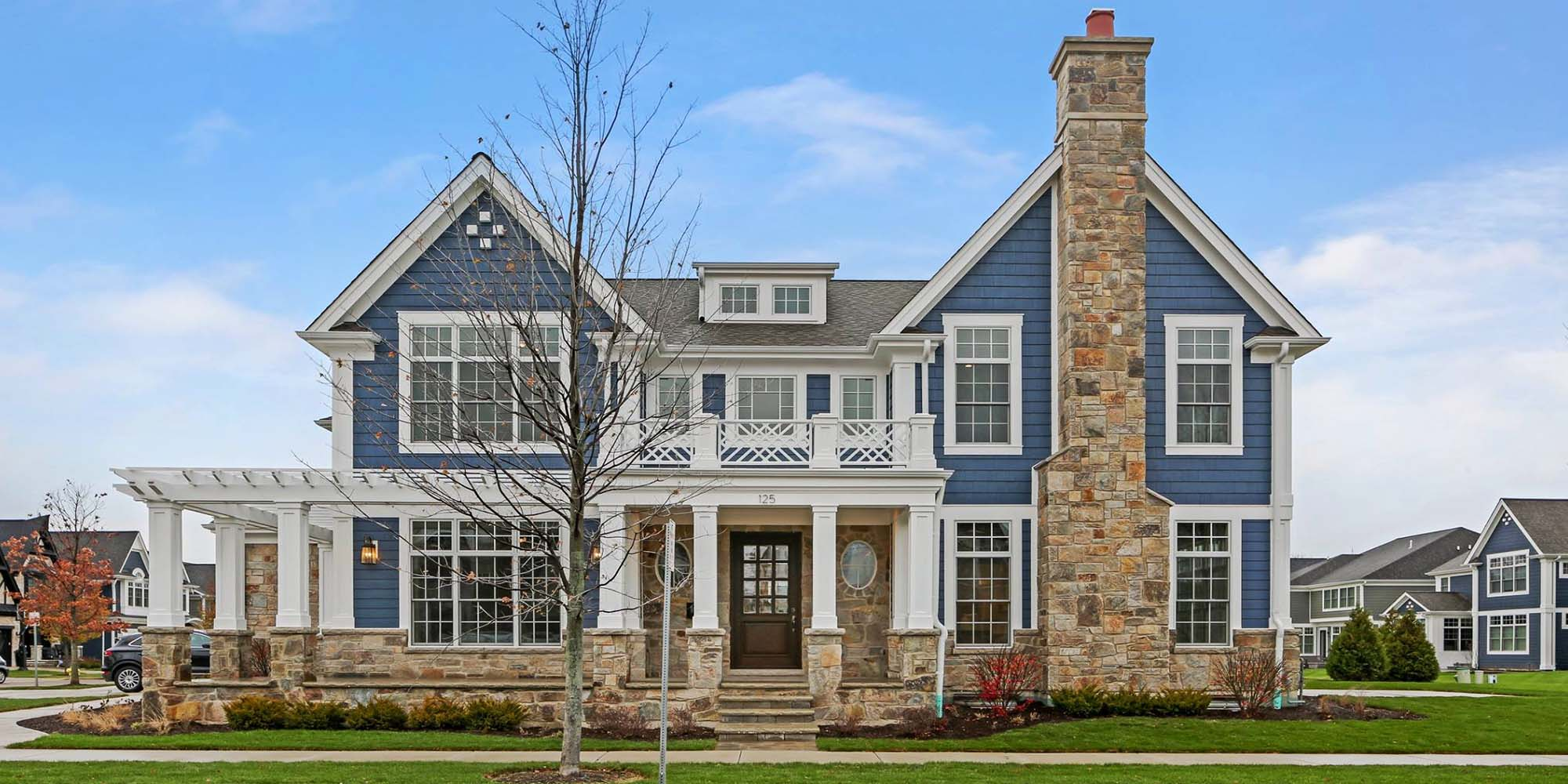top vinyl siding color schemes stunning custom built home blue siding with white trim and cultured stone veneer