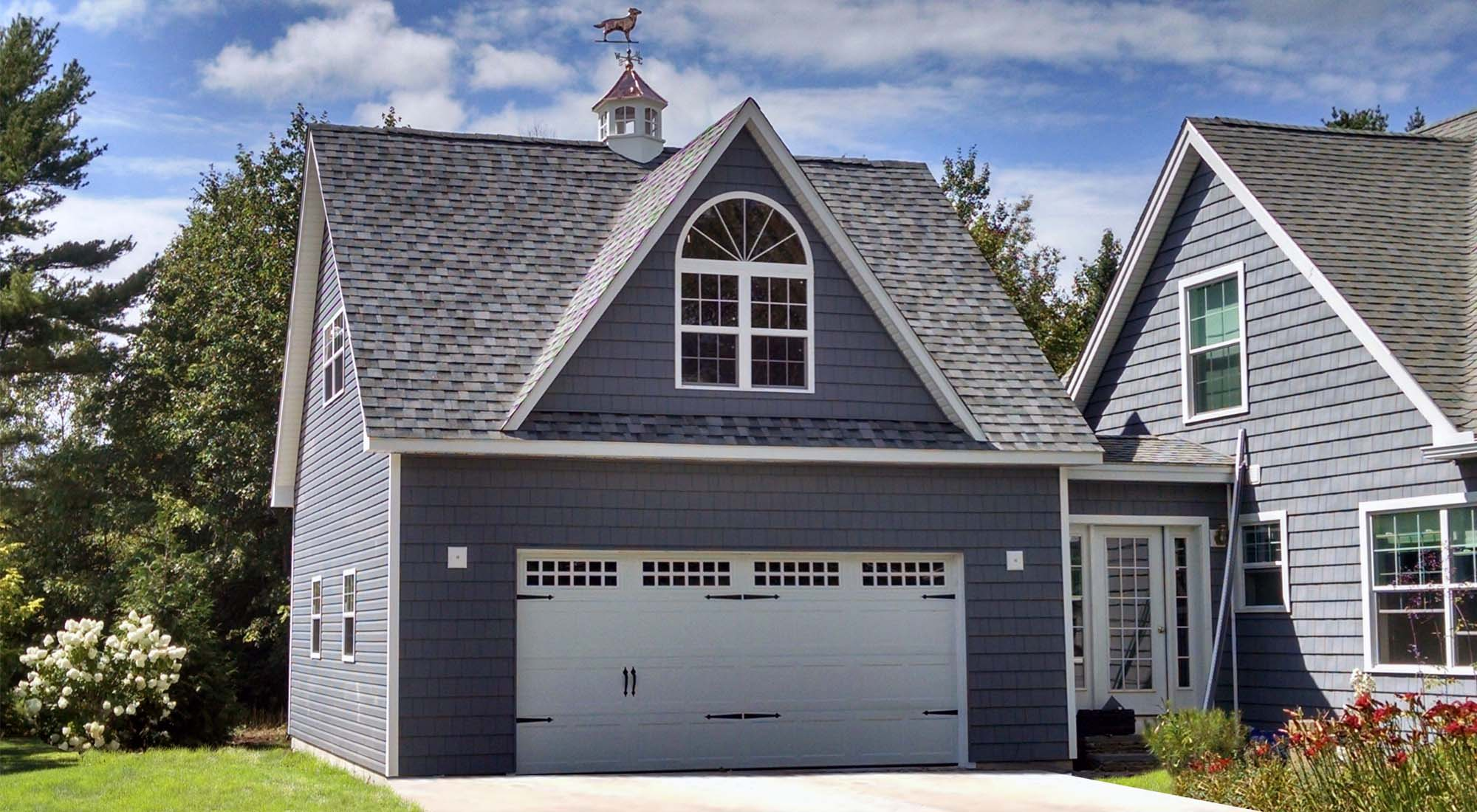 gray cedar shake siding detached attached garage with breezeway