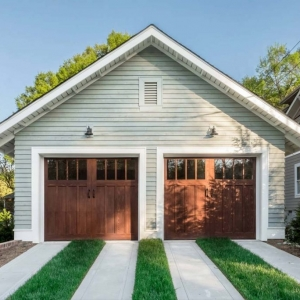 detached garage with grass and concrete driveway real wood garage doors