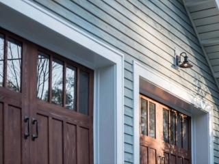 closeup view of garage doors and lap siding wood soffit exterior hardware