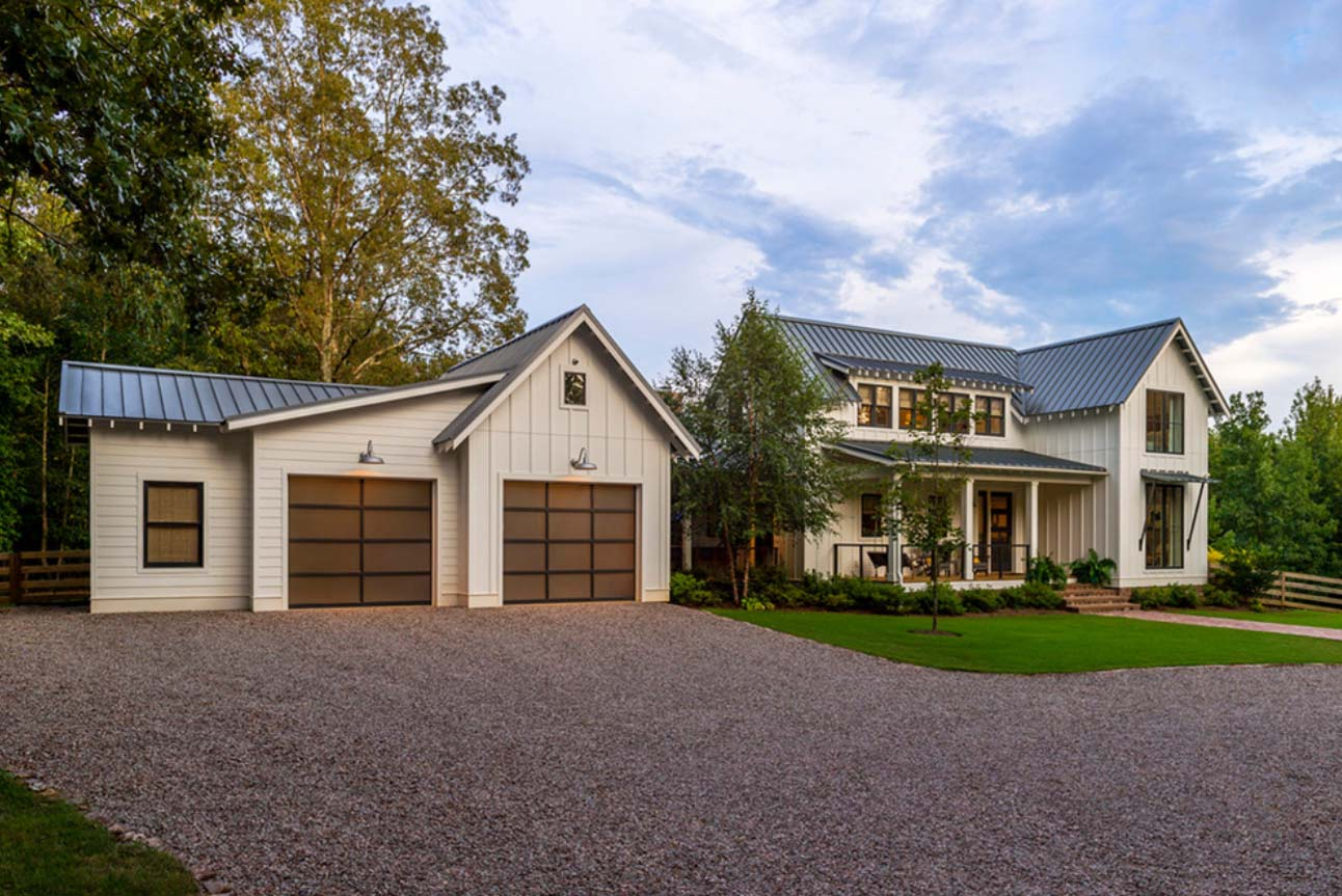 modern detached garage with white siding and black metal roof black frame windows and doors