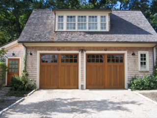detached garage cedar shake siding stained wood garage doors white trim