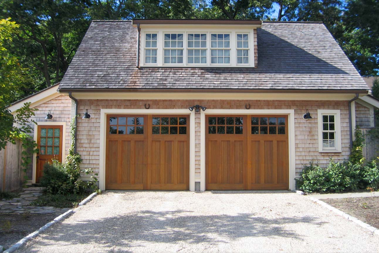 detached garage cedar shake siding stained wood garage doors white trim