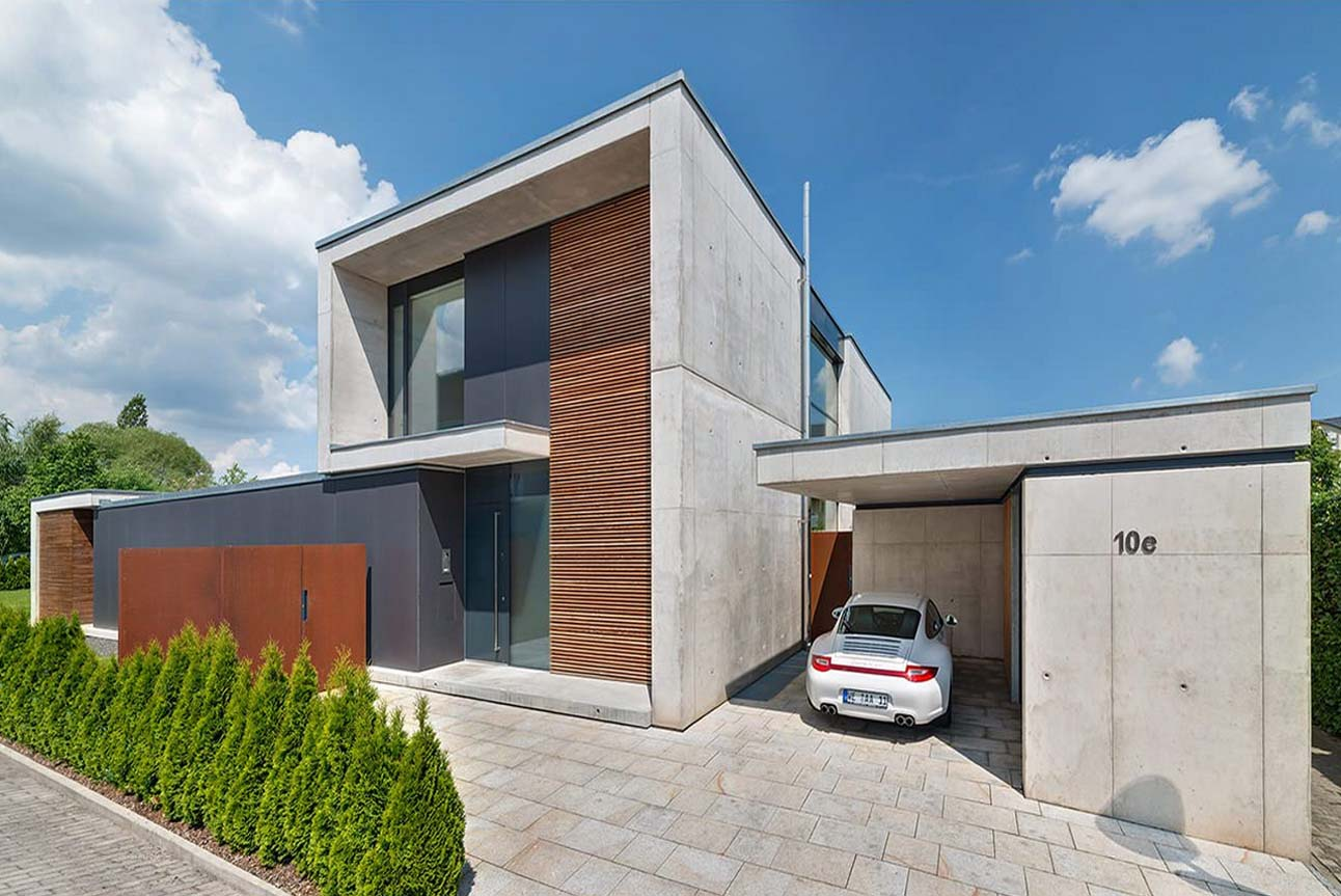 One car detached garage with contemporary style. Concrete walls with a paver floor. Flat roof.