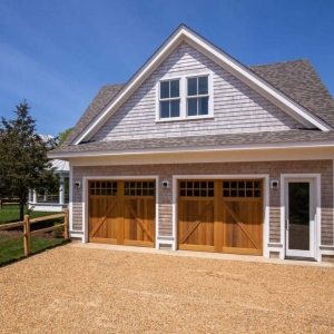 Large 2 car detached garage with 2nd floor apartment. Real wood cedar shake siding with white trim. Stained real wood garage doors.