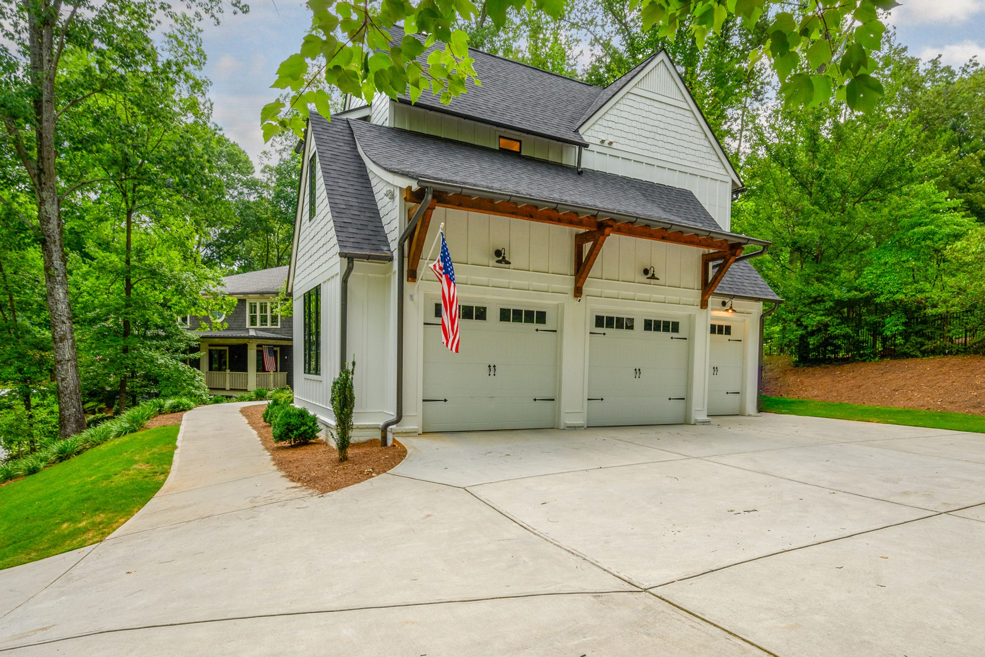 3 Car detached garage with a transitional style. vertical siding with exposed wood.