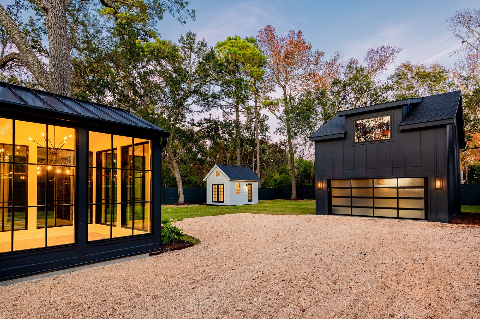 ultra modern black detached garage with large double door and 2nd floor living space