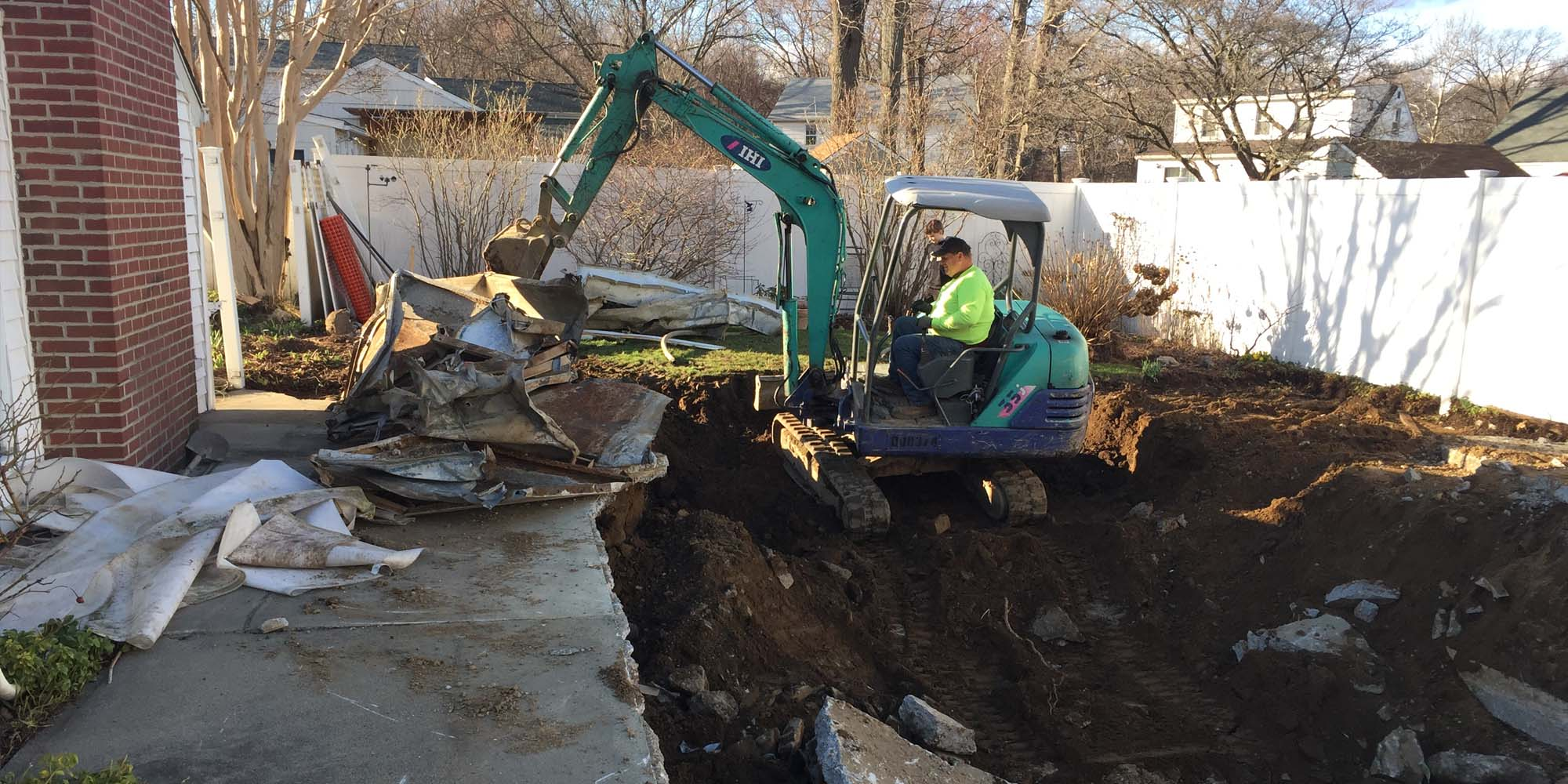 swimming pool removal NJ removing a concrete in ground swimming pool with heavy equipment - Gambrick