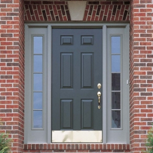 gray front door with side transoms light gray trim red brick house