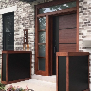 modern wood front door with glass transom brown and black with red brick house