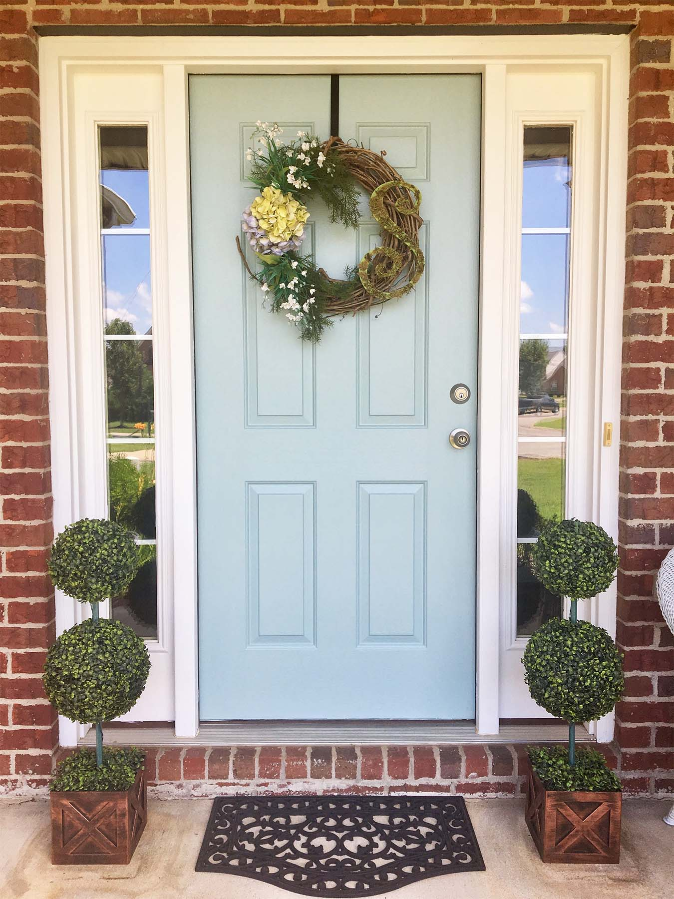 light blue front door with transoms red brick house beautiful porch plants