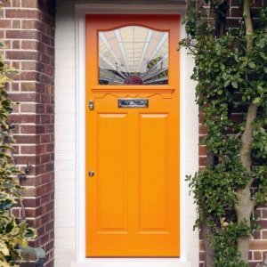 orange front door with white trim on red brick house beautiful porch plants craftsman style door glass