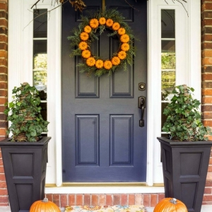 Blue front door with glass transoms white trim red brick house black porch planters