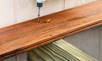 Cortex hidden deck fastener screw being installed with plug