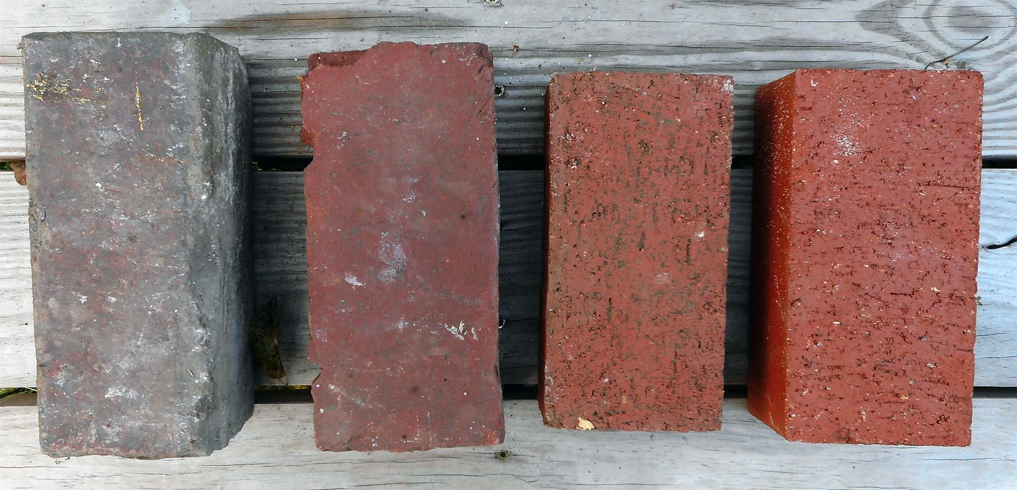front door colors for brick houses 4 red brick samples on a wooden table