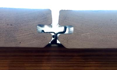 concealoc deck clips installed between deck boards