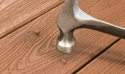 cortex hidden deck fasteners plugs being installed with a hammer