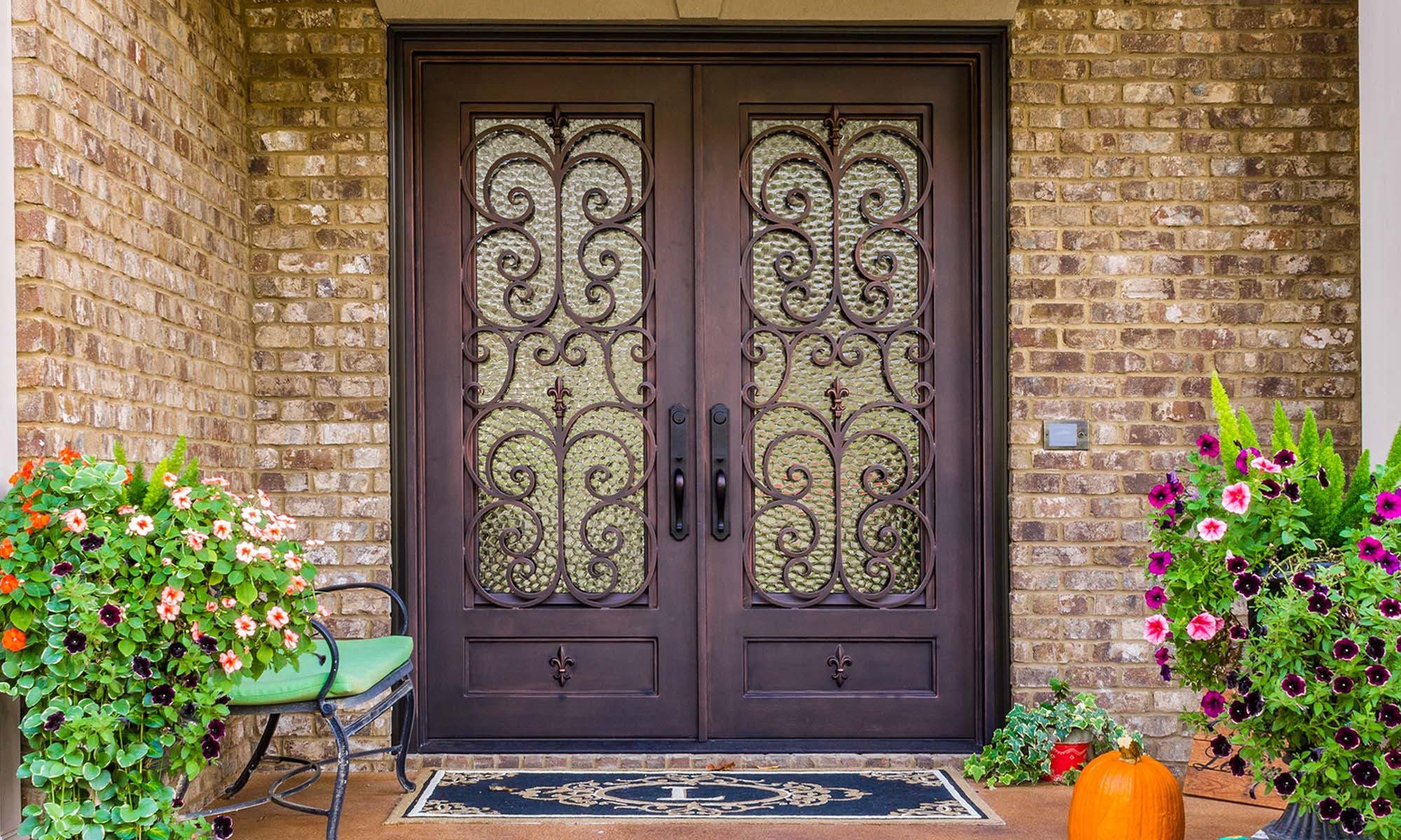 bronze brown color front door on an all red brick home