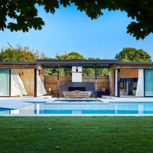 modern flat roof pool house designs concrete in ground pool with concrete patio outdoor fireplace
