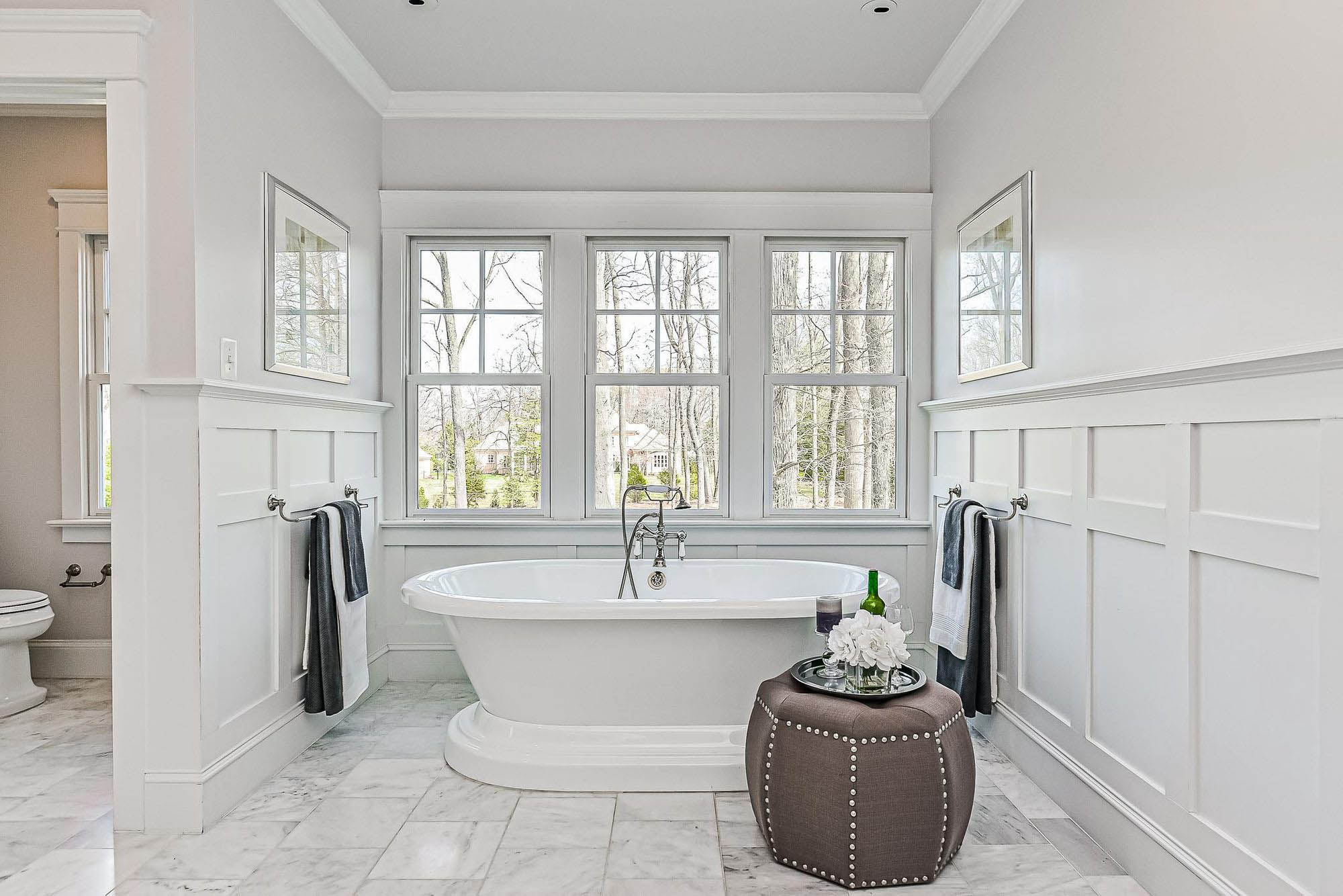 White wainscoting bathroom walls with a box beam design. What a wonderful way to class up your bathroom.