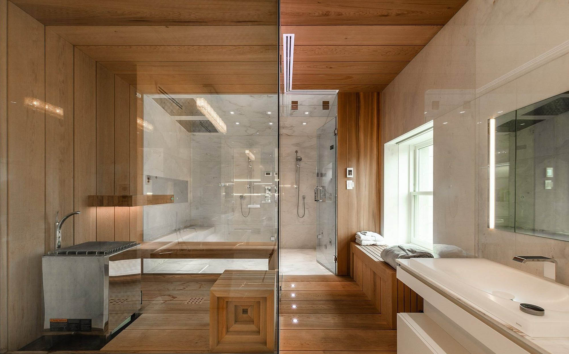 Modern bathroom design with wood wall paneling. Light natural wood finish with just a sealant on the floors, walls and ceiling.