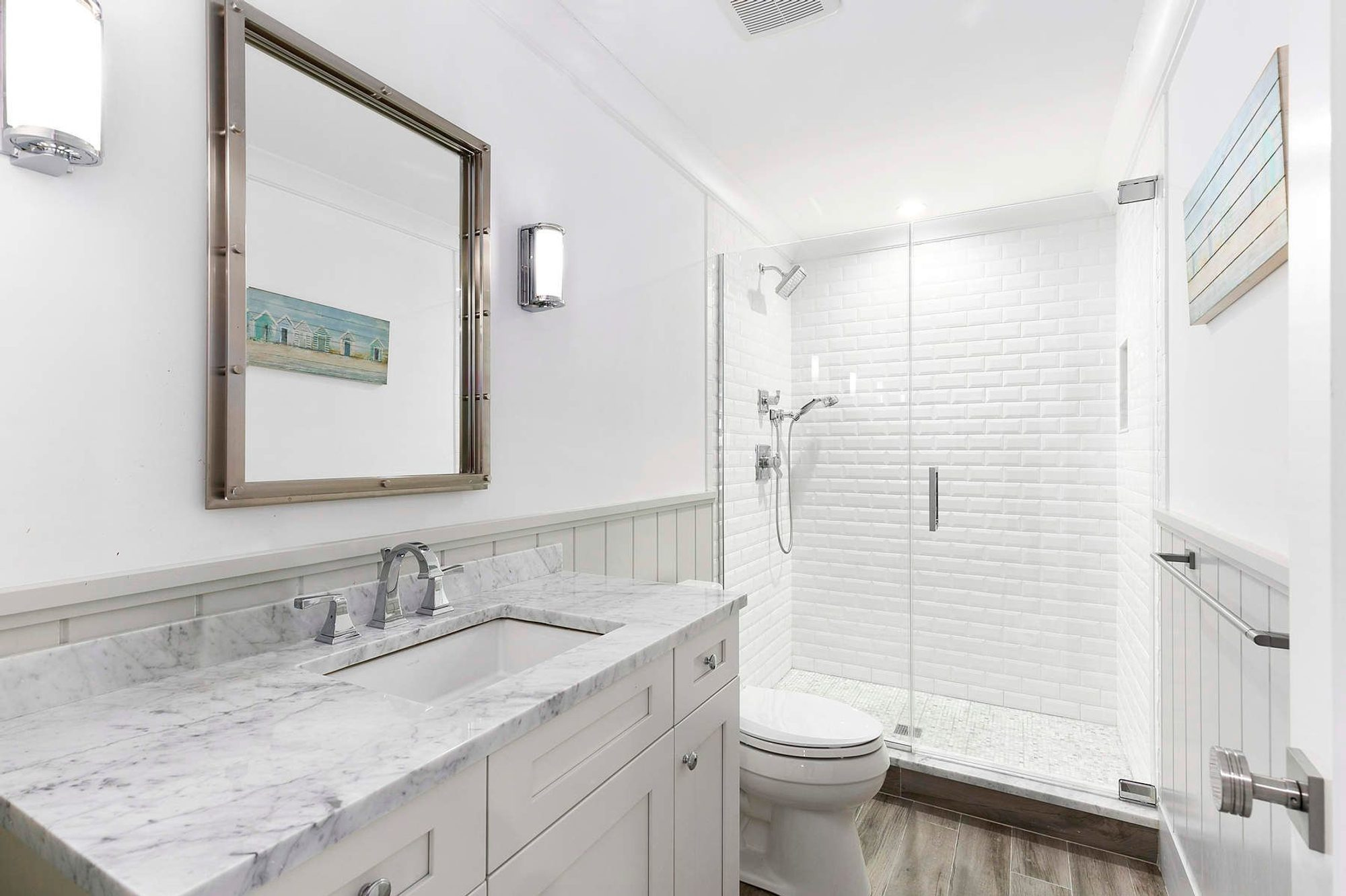 Here we see vertical shiplap wall paneling used as wainscoting. With a small bathroom vertical paneling works better. it makes a small space feel larger.