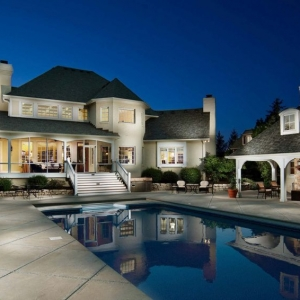 stucco and stone pool house design outdoor fireplace concrete patio in ground concrete pool
