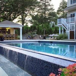 negative edge swimming pool small pool house design real stone blue tile landsaping