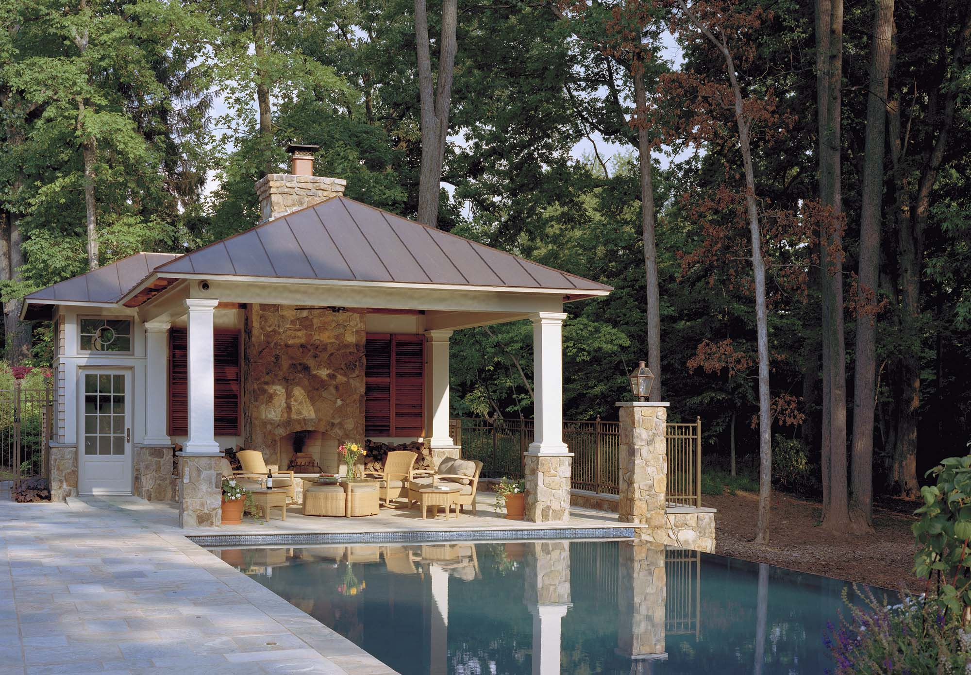 beautiful small pool house design real stone chimney outdoor fireplace tile patio columns with stone base