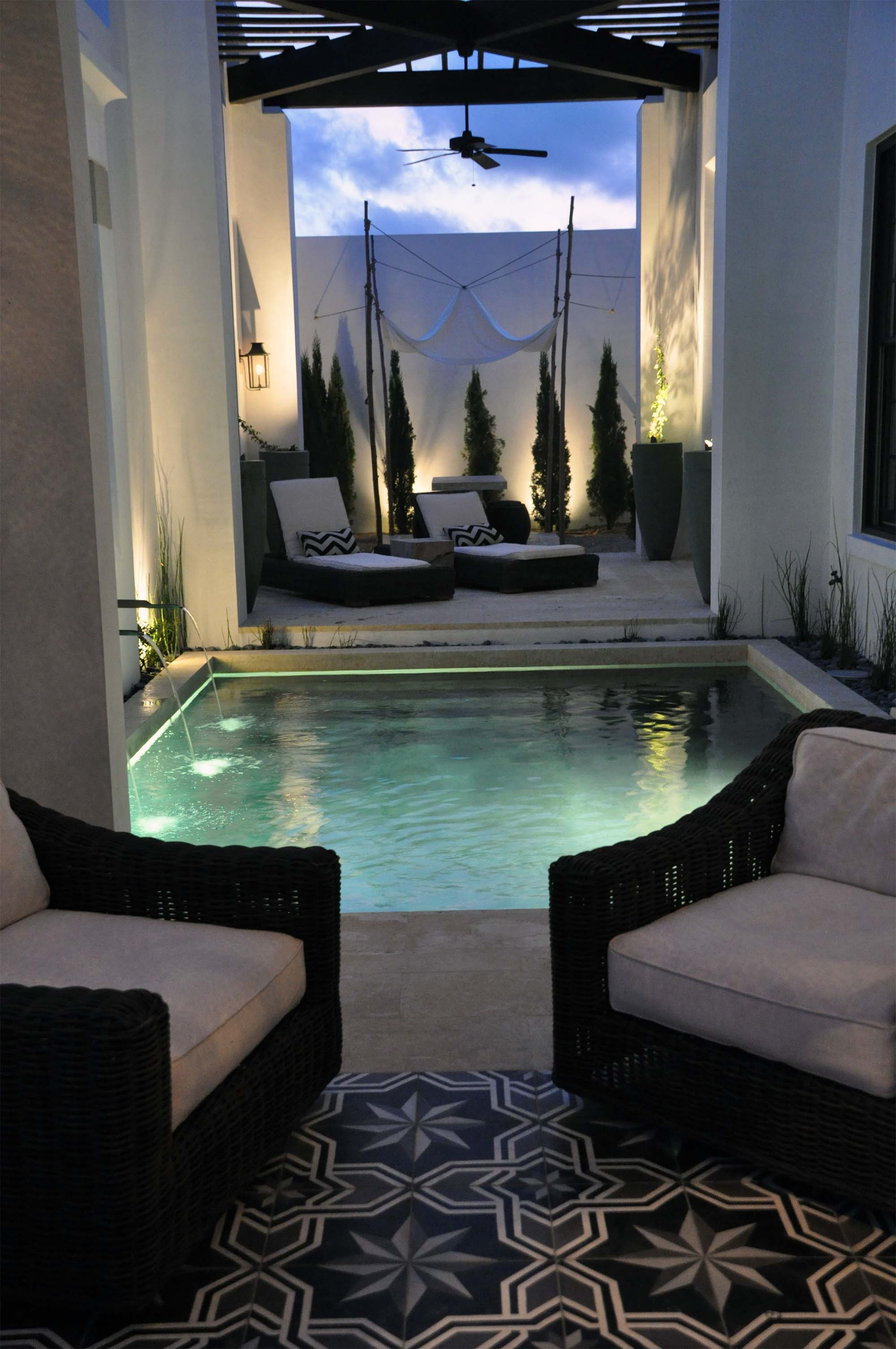pool house interior stucco walls stone floor wicker furniture white cushions