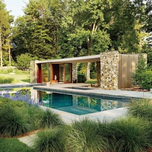 modern flat roof pool house design real stone with blue stone patio in ground concrete pool landscaping