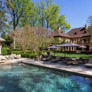 stunning pool house design and mansion real stone hardscaping patio in ground concrete pool