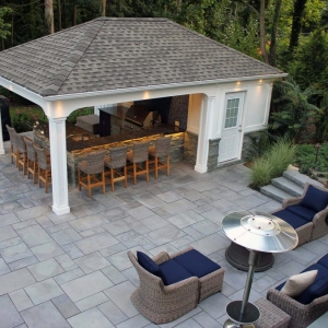 cute pool house with outdoor kitchen stamped concrete patio white columns