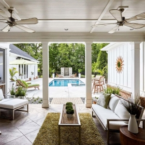 interior pool house design white siding light and bright patio furniture white cushions