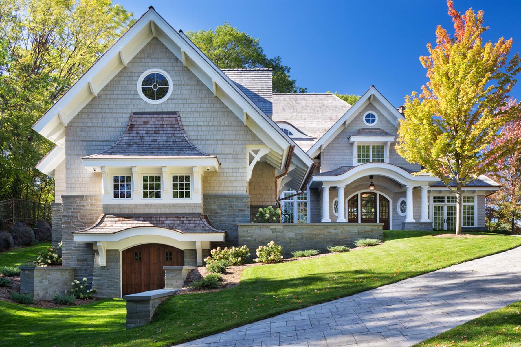light gray house with dark brown front door rich home beautiful custom