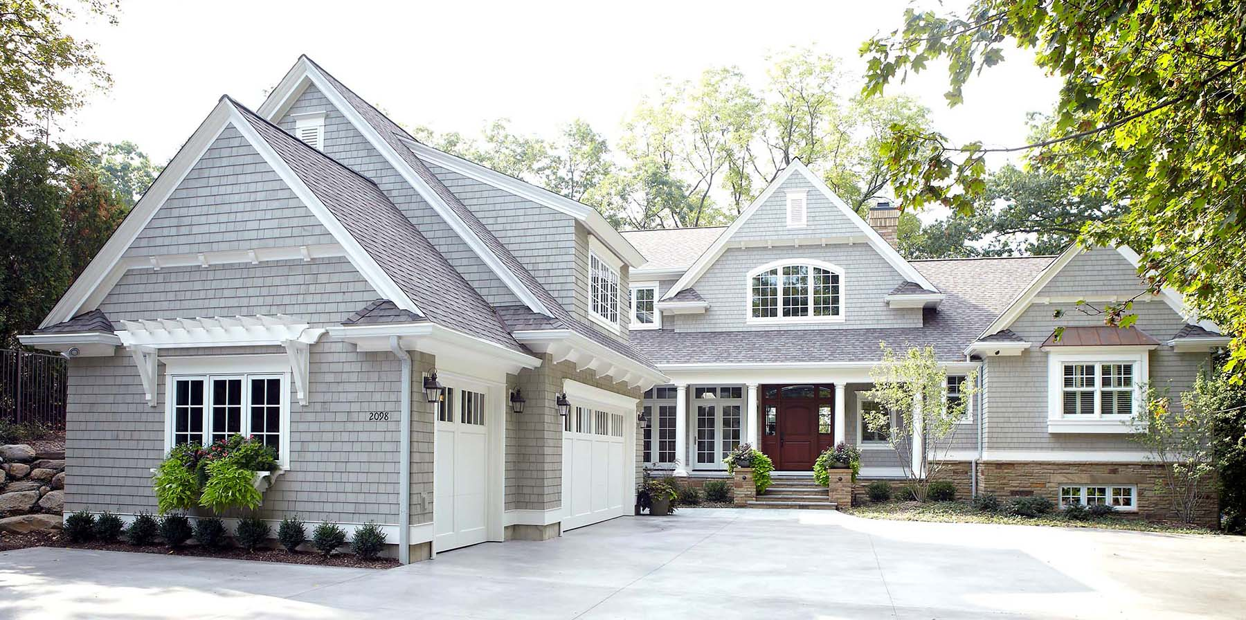 what color siding is best for resale value gray cedar shake with white trim and a dark brown entry door