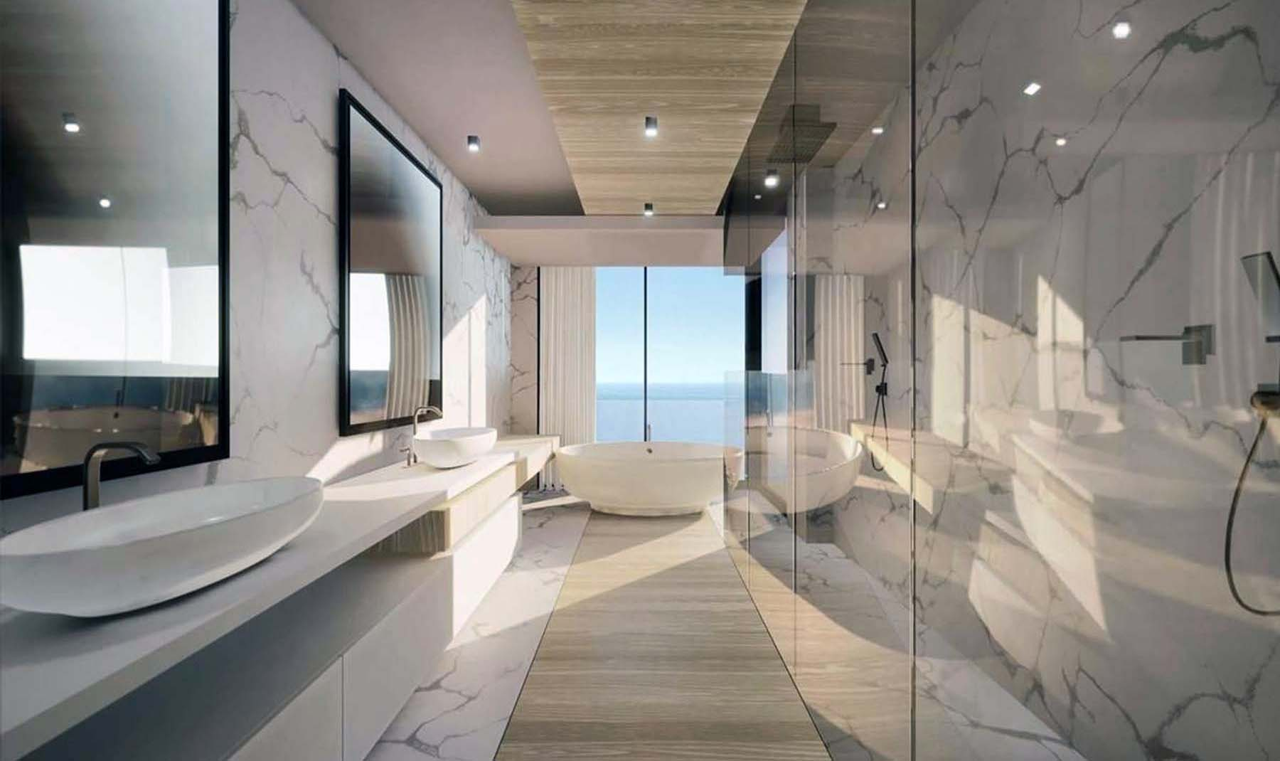 Beautiful modern bathroom design with an ocean view. What kind of bathroom could be better than this. Marble and real wood with glass and stone.