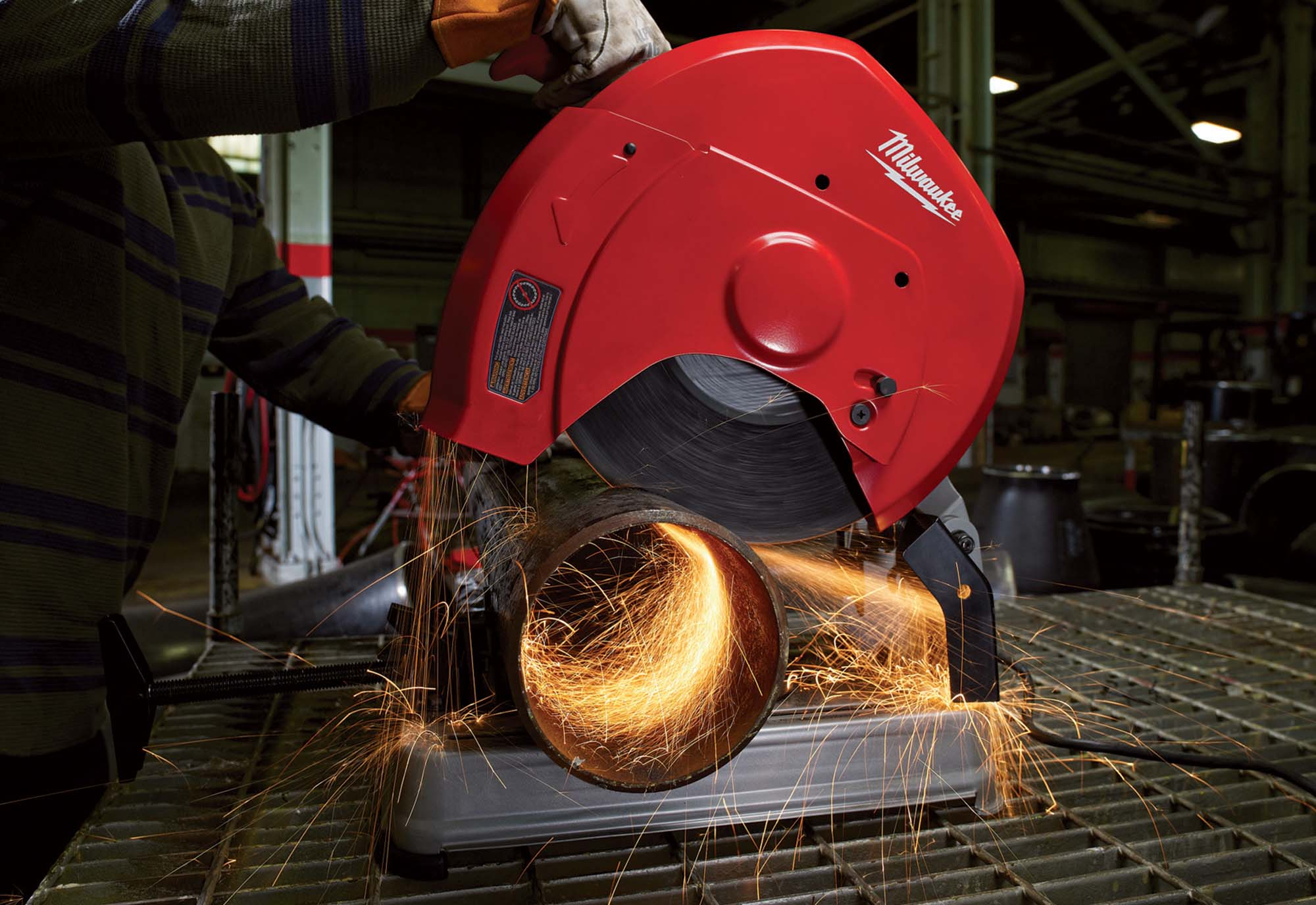 Milwaukee chop saw cutting metal pipe