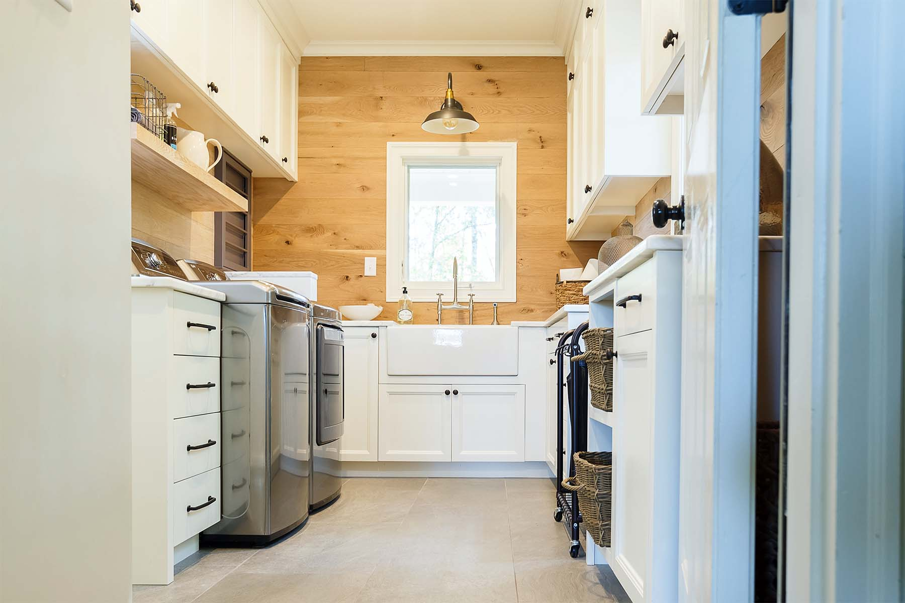 luxury laundry room white built ins with sink and countertop wood shiplap walls